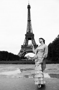 Romantic vacation travel photo of luxury model in from of Eiffel Tower Paris