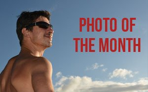 TripShooter Vacation Photographer Button Man on Holidays Sunny Skies