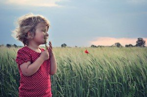 Young girl in field of poppies on family vacation in Munich Germany