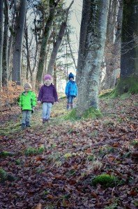 Children's portrait of kids exploring forest in Munich Germany on vacation