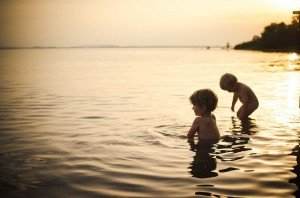 Vacation Portraits of Children at play at sunset in Germany Europe