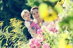 Natural portrait of mother and child in spring garden by TripShooter Vacation Photographer Anette Mayerhofer