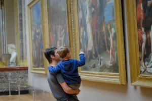 Father and son find things to do in Paris when they look at art in the museum in Paris France