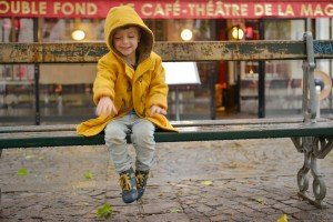 Travel portrait of boy on bench in Paris France