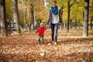 Young girl and baby walk through Luxembourg Gardens in Paris in Fall with TripShooter Vacation Photographer