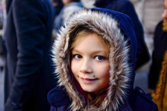 Cassie Jones TripShooter Vacation Photographer in Amsterdam - blue-eyed girl in winter cape