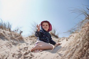 Child exploring on summer beach holiday, by Dawid Zydorek, TripShooter Vacation Photographer in Dublin