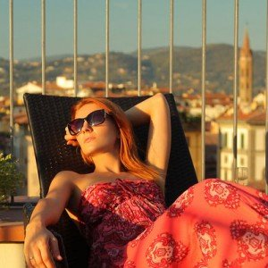 Sample photo for TripShooter Florence vacation photographer header - woman relaxing luxury trip