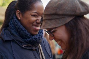 Girlfriends laugh and enjoy good times together with TripShooter Vacation Photographer in Paris