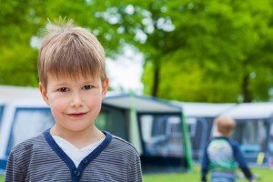 Family camping holiday, boy in campground, by TripShooter Vacation Photographer in Dublin, Ronald Bouman