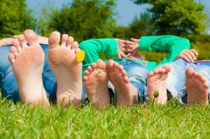 Family feet relaxing on summer holiday, by TripShooter Vacation Photographer in Dublin, Ronald Bouman