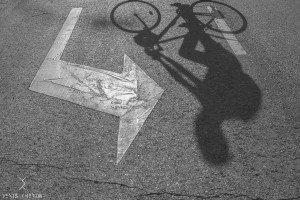 Denis Cherim TripShooter vacation photographer in Madrid - cyclist and shadows
