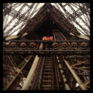 The lift in the Eiffel Tower looking up