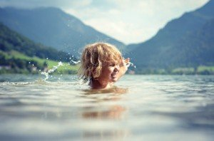 Portrait of young girl learning to swim in Germany on vacation by TripShooter Vacation Photographer in Munich Anette Gottlicher