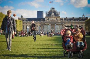 Family and children in stroller on Champ de Mars Paris France