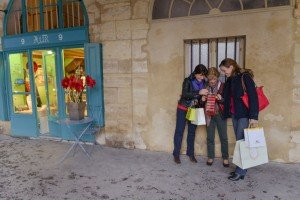 Happy tourists examine their purchases after shopping with a vacation photographer in the Marais Paris France