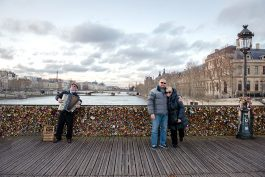 Loving couple and piano accordion vacation portrait Paris France
