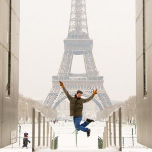 Vacation photo jumping in front of Eiffel Tower Paris France
