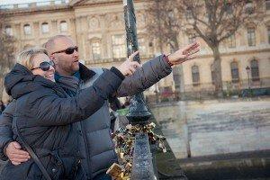 Romantic couple throw love-locks in the Seine in Paris
