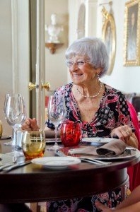 Retirement anniversary happy woman photo at special occasion dinner wearing luxury pearls