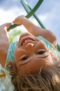 Happy children's portrait of smiling girl at play on vacation by TripShooter Vacation Photographer in Lisbon, Ricardo Junqueira
