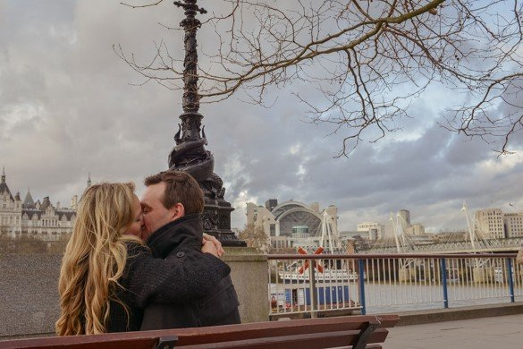 Beautiful couple kiss by the Thames in London by TripShooter honeymoon photographer