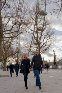 Romantic couple photos with TripShooter honeymoon photographer in London - couple walking at London Eye