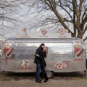 Sweet romantic picture in London food stand by TripShooter honeymoon photographer