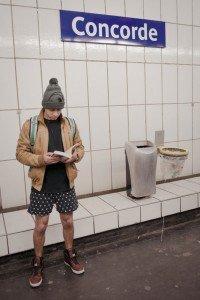 No Pants Subway Ride Paris 2014 man in underwear reading on metro