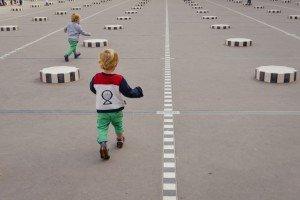 Twins running on vacation at Palais Royale Paris France
