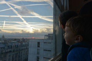 Children watching clouds over Paris France