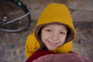 Bright Eyes Happy Vacation Child in Yellow Jacket