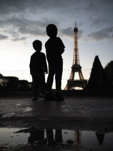 Children and Eiffel Tower Silhouette at Paris Dusk