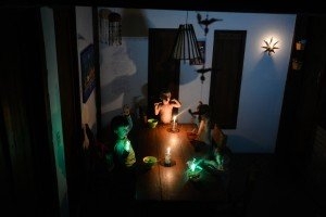 Four children sit with candles in an electricity shortage while on vacation in exotic Brazil
