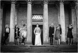 Happy destination wedding party with columns