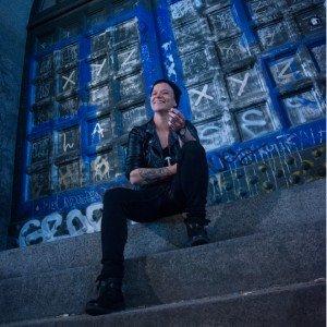 Portrait of happy solo traveller with blue Copenhagen window