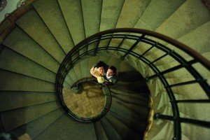 Matthew Harrison TripShooter Vacation Photographer in Copenhagen - romantic couple in green spiral staircase