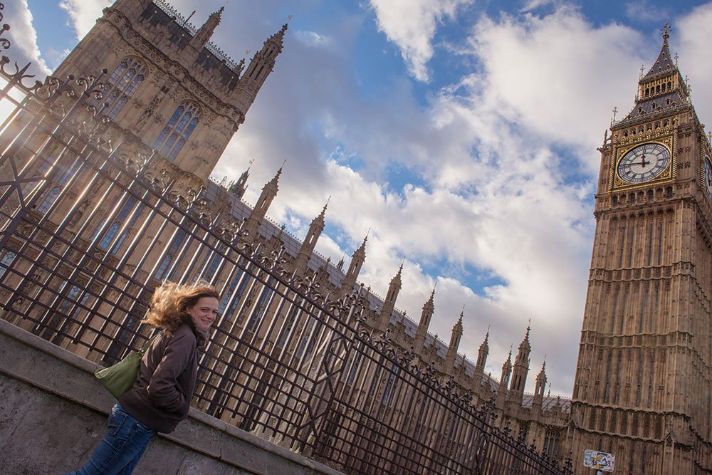TripShooter Vacation Photographer London - woman walking past Big Ben British Parliament