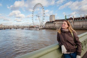 TripShooter Vacation Photographer London - woman on Westminster Bridge with London Eye