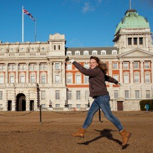 TripShooter Vacation Photography London - woman jumps outside Horses Guards Buildings, Whitehall