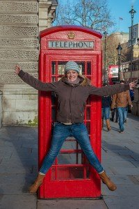 TripShooter Vacation Photographer London - woman jumping outside British red telephone booth.