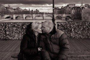 Romantic photos of couple kissing on love bridge in Paris France