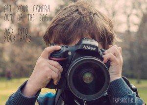 Small Boy Holding Nikon Camera on Vacation