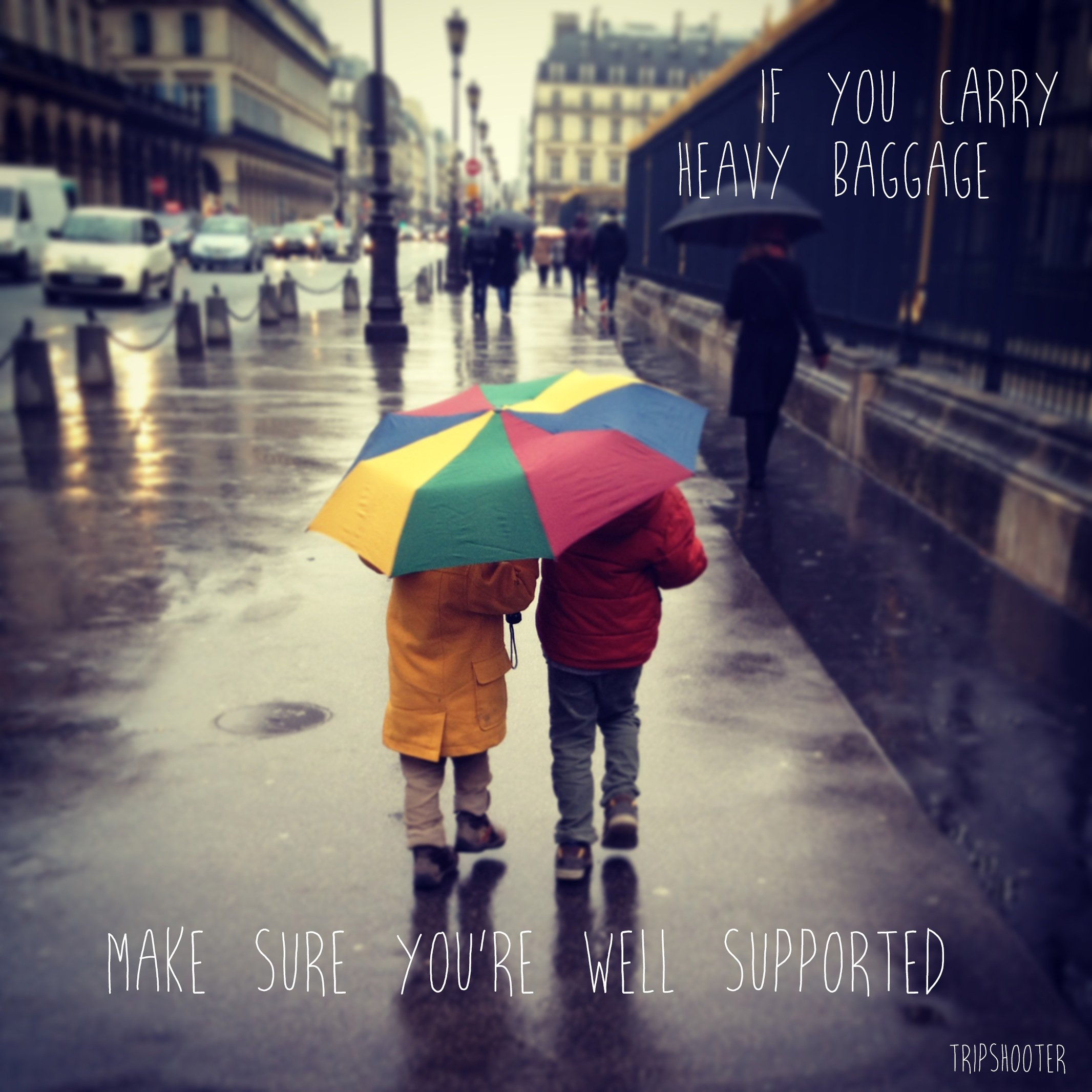 Two small boys under bright umbrella help each other photographer inspiration