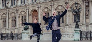 Daughter and father jumping at the Hotel de ville