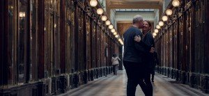 Hugging couple in a Paris arcade