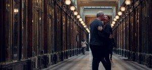 Hugging couple in a Paris arcade