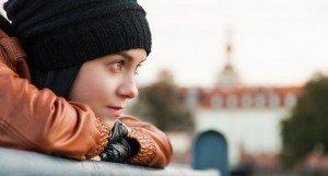 Girl looking over a bridge