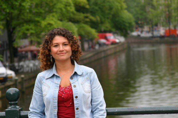 Woman on a bridge in Amsterdam, The Netherlands