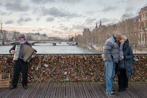Couple Kissing With Padlocks on Pont des Arts, Paris